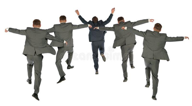 在企业拼贴画跳的小组之后 库存照片