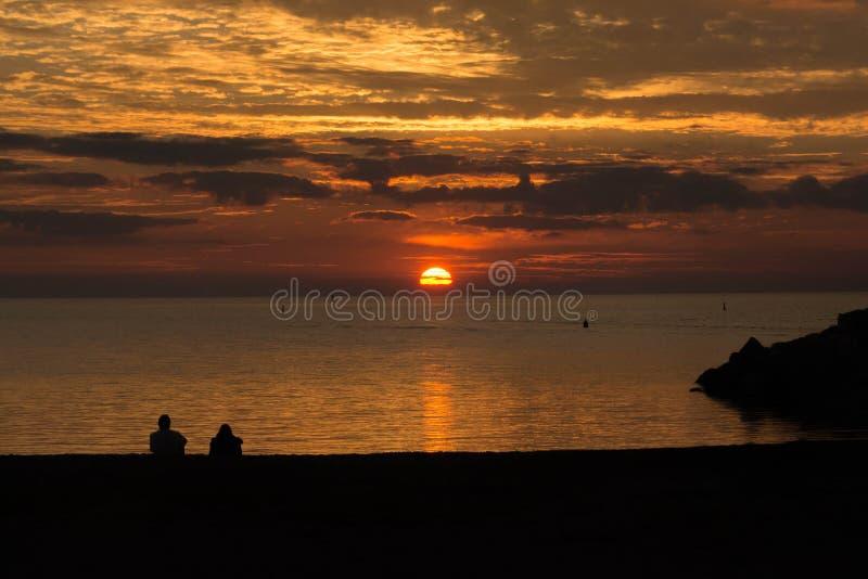 在休伦湖的平静的日落 免版税库存图片