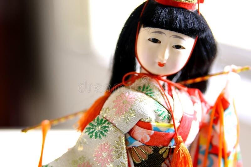 在传统礼服的日本艺妓玩偶 免版税库存图片
