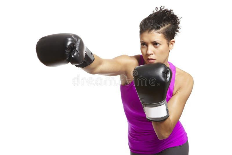 在体育运动成套装备的少妇拳击 图库摄影