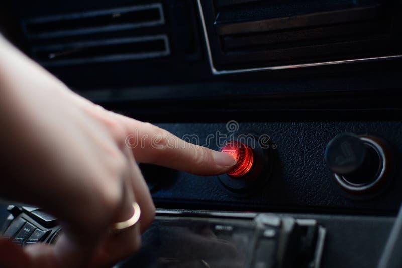 在俄国汽车的黑控制板有一个紧急刹车按钮的 免版税库存照片