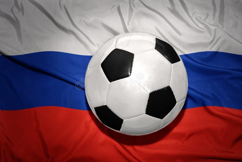 在俄罗斯的国旗的黑白橄榄球球 库存照片