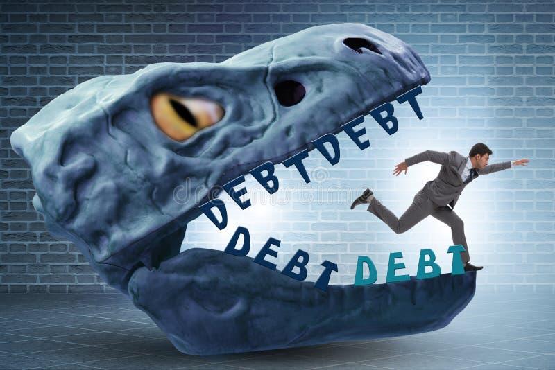 在债务和贷款的下颌的商人 免版税库存照片