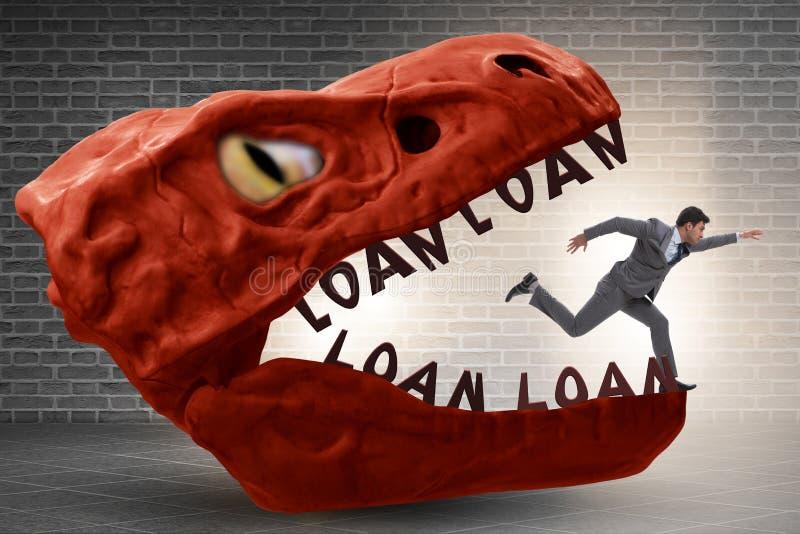 在债务和贷款的下颌的商人 免版税库存图片