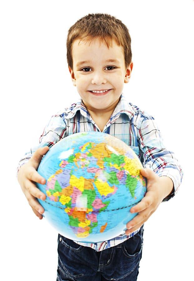 在儿童手上的地球 图库摄影