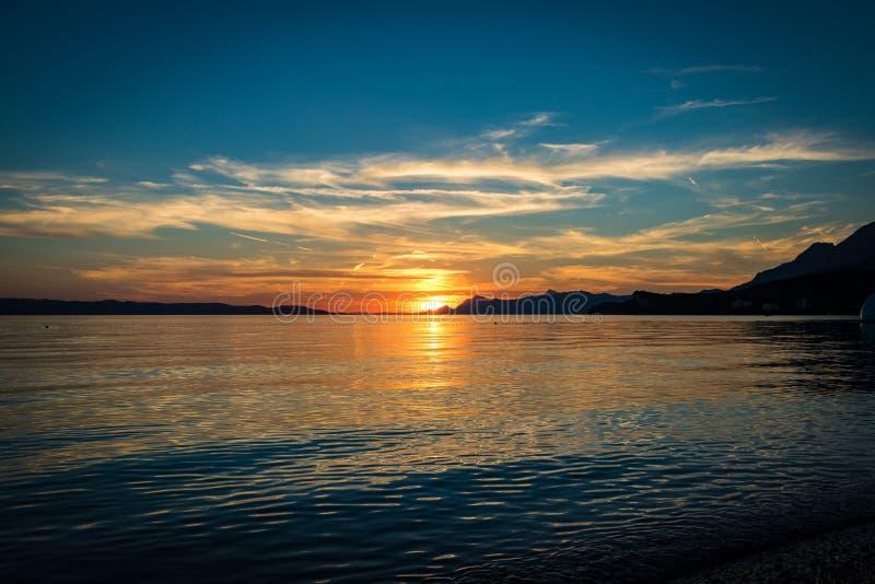 在克罗地亚海滩的日落 免版税库存图片