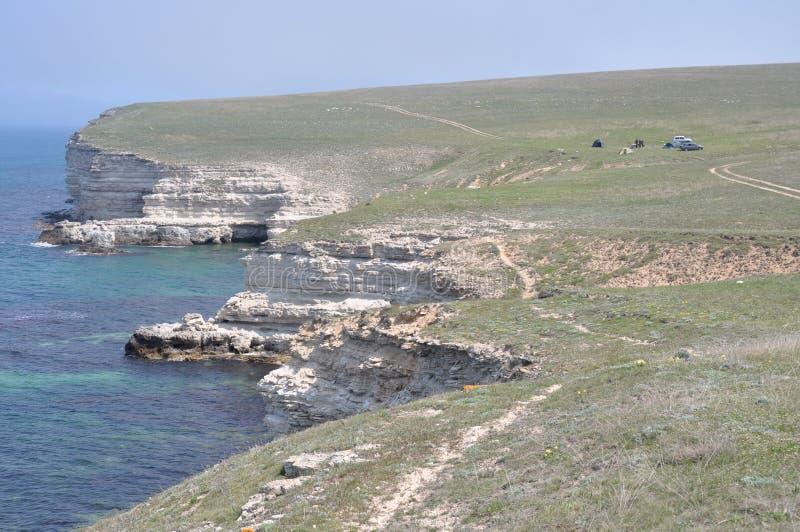 在克里米亚半岛海岸的岩石岸 免版税库存照片