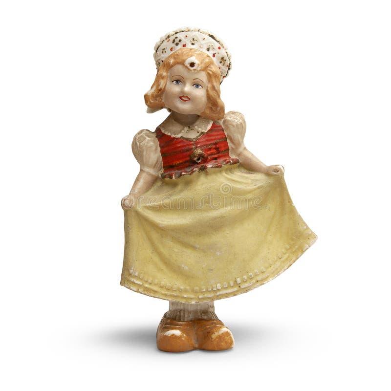 在全国衣裳的葡萄酒女孩的雕塑 免版税库存图片