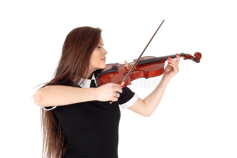 在关闭的一个妇女身分,弹小提琴 免版税库存照片