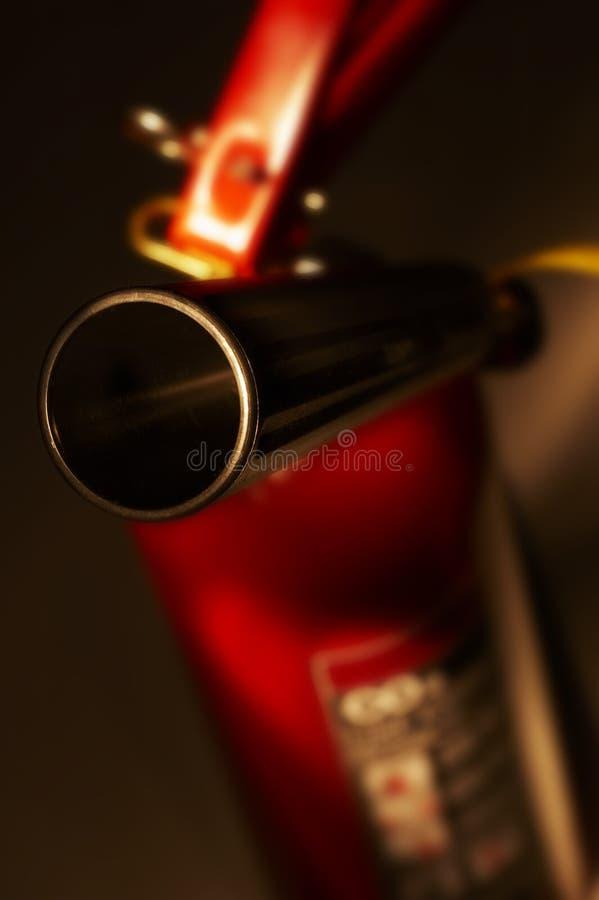 在关闭的红色二氧化碳灭火器 免版税库存照片