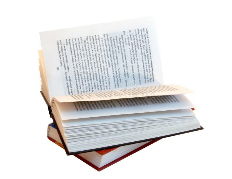 在其他书上面的被开张的书 图库摄影
