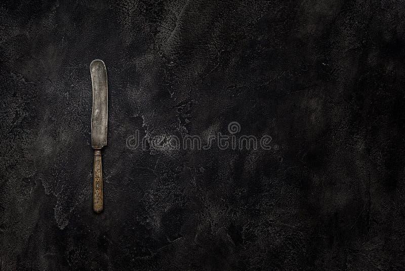 在具体顶视图的老农庄刀子 免版税库存照片
