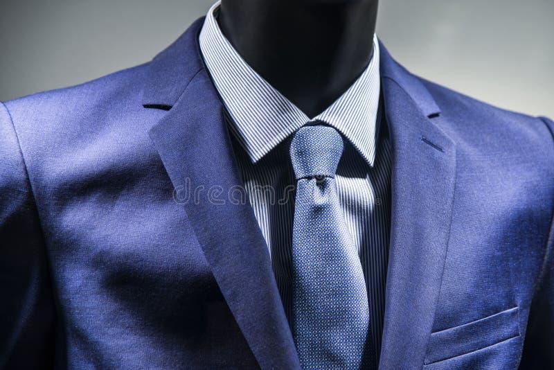 在典雅的蓝色衣服的领带 图库摄影