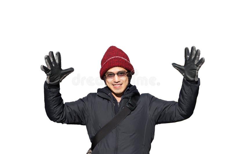 在冬天帽子的亚洲男性在夹克培养手上被隔绝在whi 免版税库存照片