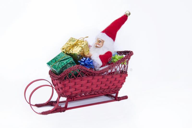 在冬天雪橇的圣诞老人项目 免版税库存图片