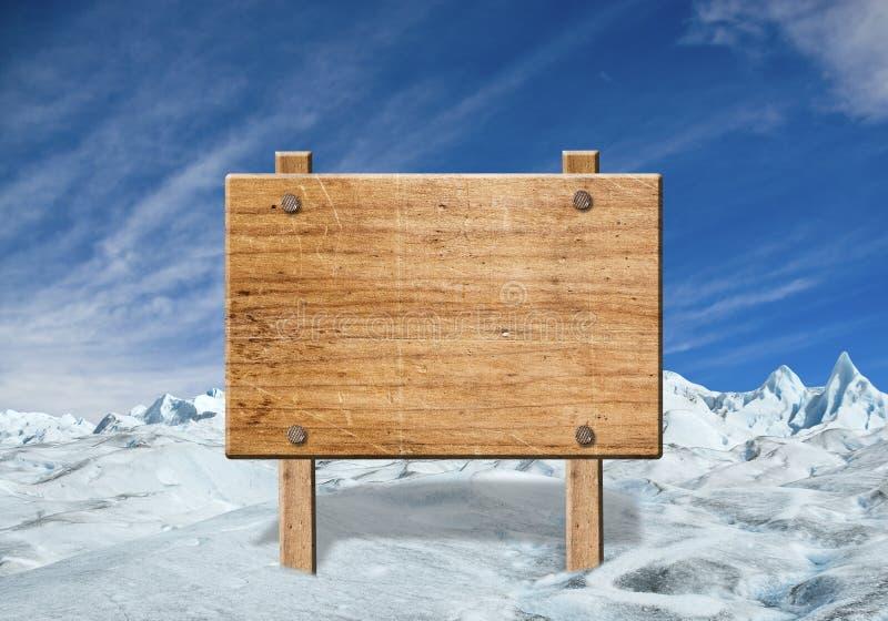 在冬天风景的木标志 免版税库存图片