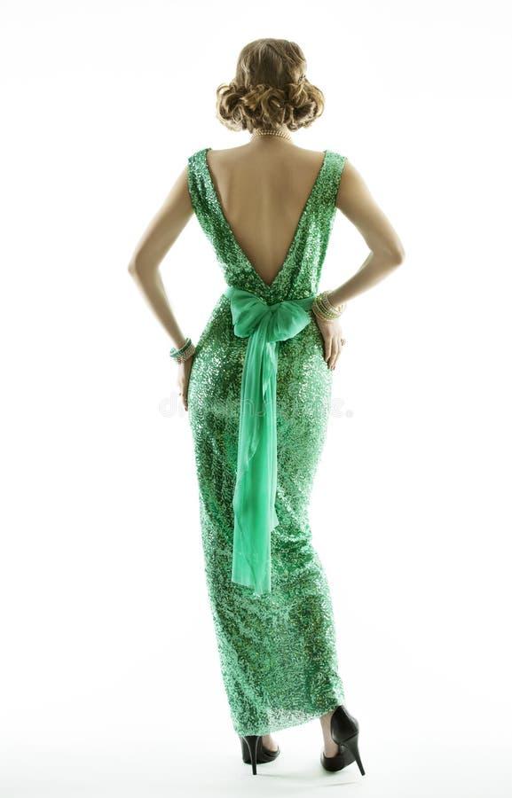 在减速火箭的时尚衣服饰物之小金属片礼服的妇女后面,典雅的葡萄酒样式 库存图片