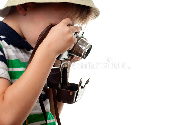 在减速火箭的照片照相机的小男孩射击 图库摄影