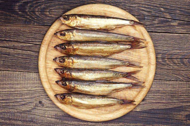在切板的熏制的鱼 图库摄影