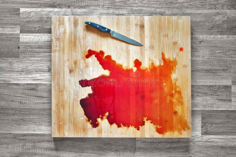 在切板的血液 免版税库存照片