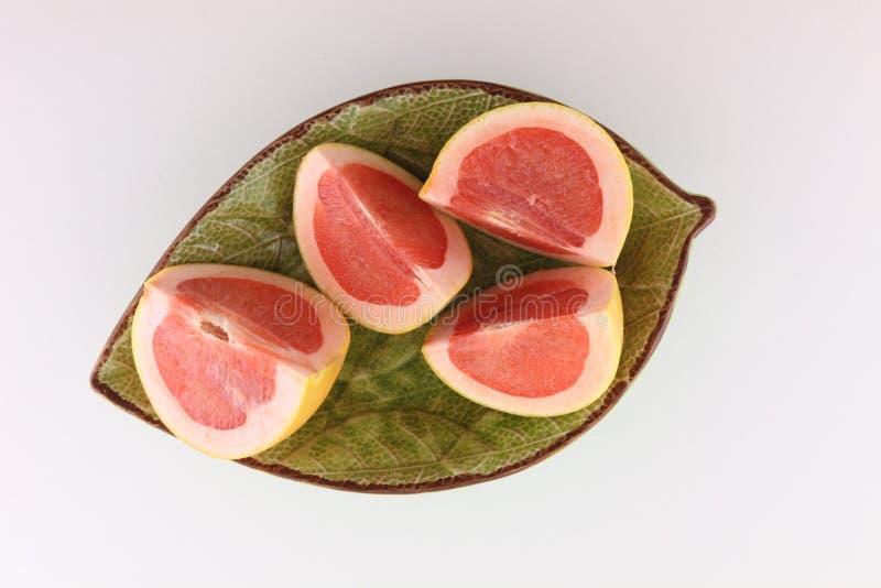 在切片切的葡萄柚 免版税库存照片