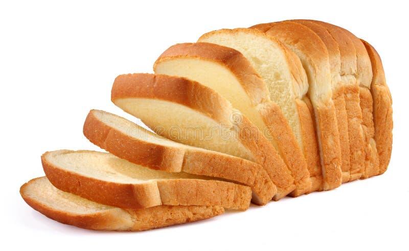 在剪切上添面包 免版税图库摄影