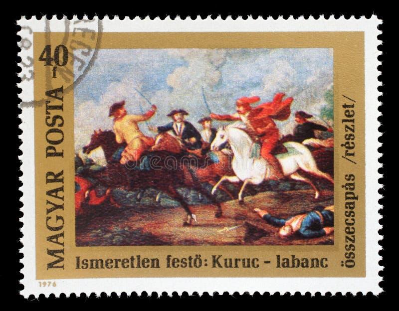 在匈牙利打印的邮票为费伦茨Rakoczi II王子展示300th诞生周年发布了在Rakoczi ` s库鲁之间的冲突 免版税库存图片