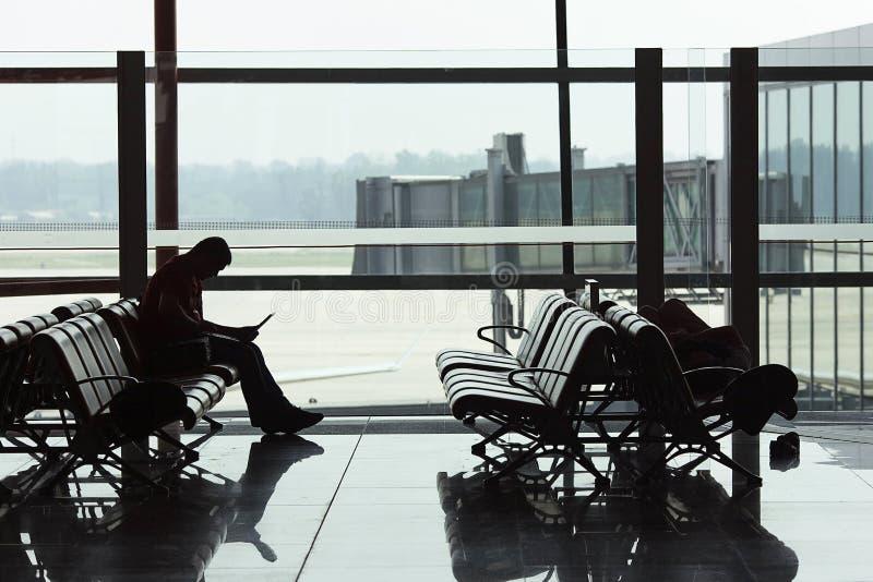 在北京首都国际机场的等待的pasenger 免版税库存图片