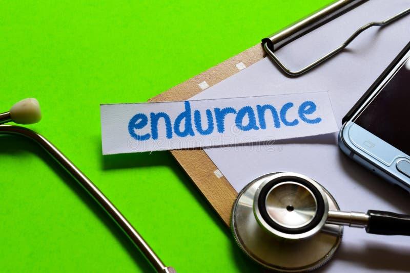在医疗保健概念的耐力有绿色背景 免版税库存照片