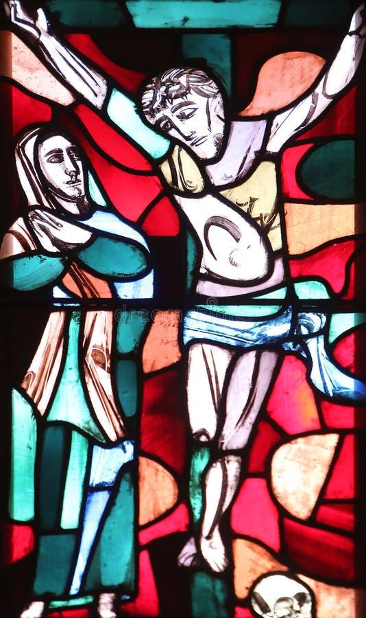 在十字架下的玛丽 库存照片