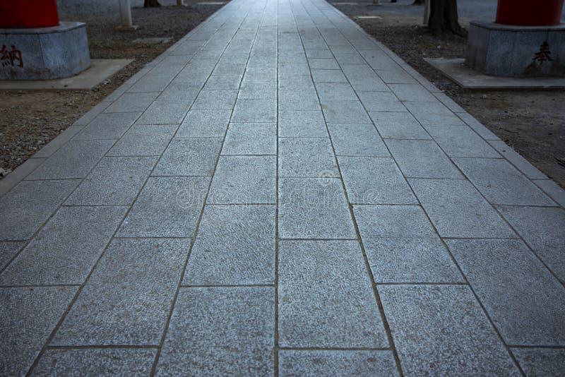 在华园寺庙的石街道在新宿东京 免版税图库摄影