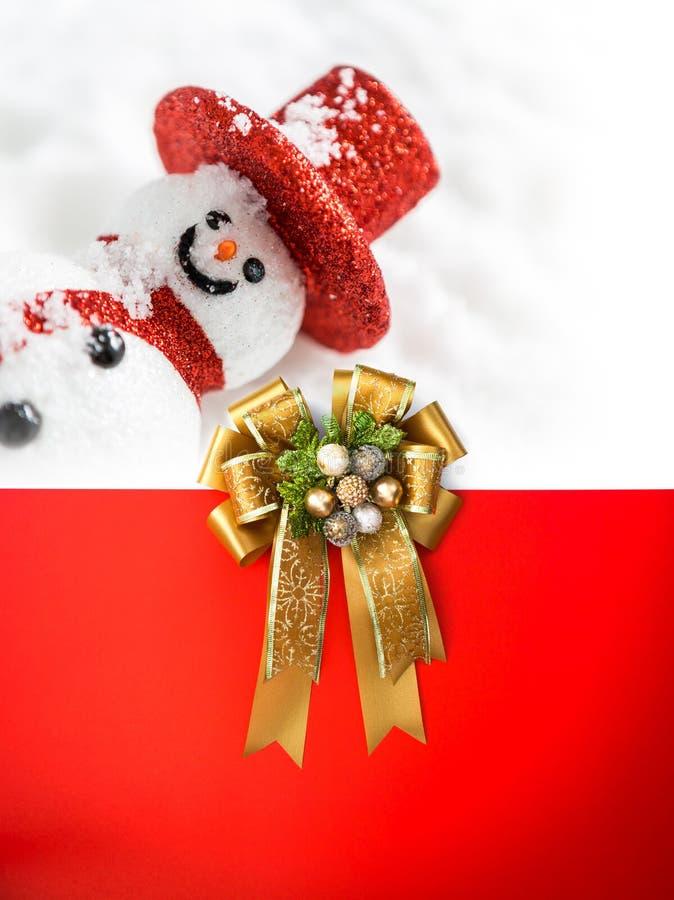 在卡片的圣诞节装饰与丝带弓 库存照片