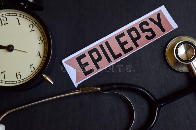 在印刷品纸的癫痫症与医疗保健概念启发 闹钟,黑听诊器 库存图片