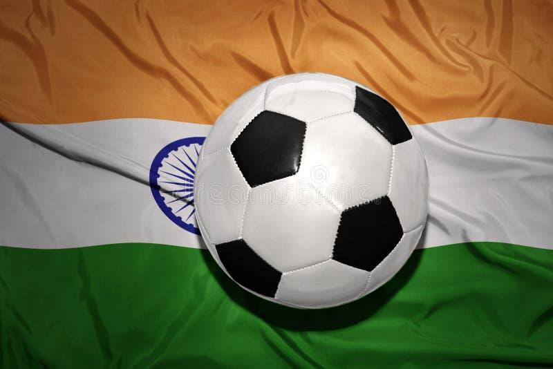 在印度的国旗的黑白橄榄球球 库存照片