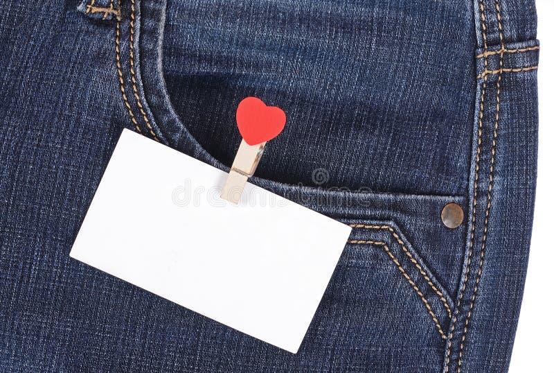 在口袋牛仔裤的贴纸 图库摄影