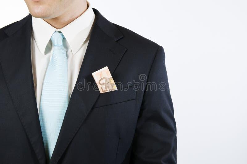 在口袋的金钱 免版税库存图片