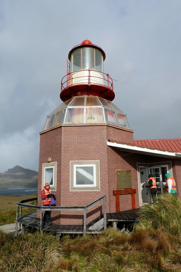 在合恩角的著名灯塔-火地群岛群岛的最南端的点,洗涤由德雷克的水 免版税图库摄影