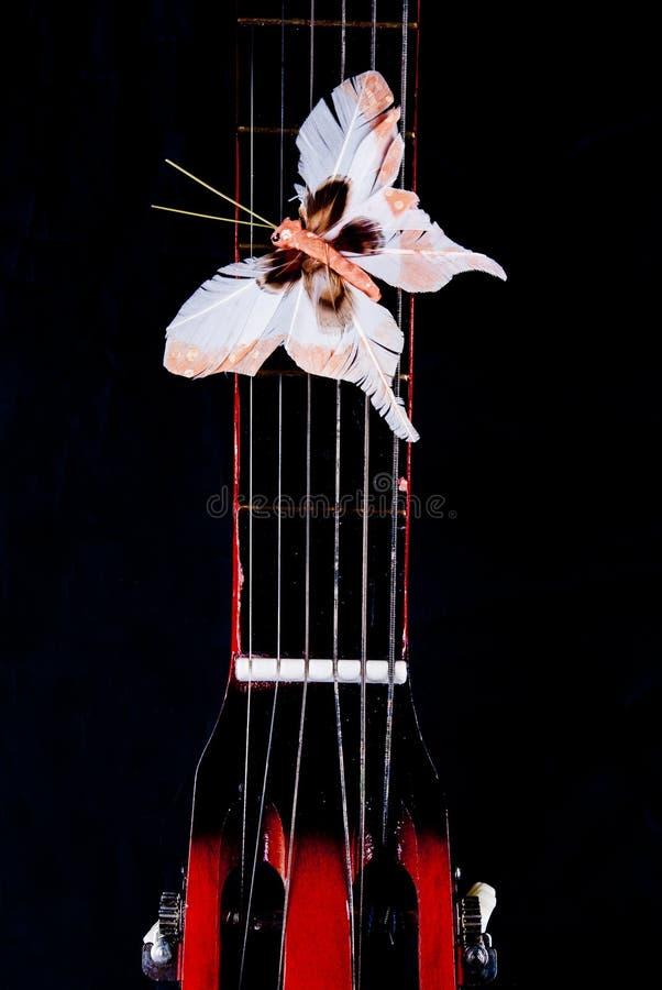 在吉他的蝴蝶 免版税图库摄影