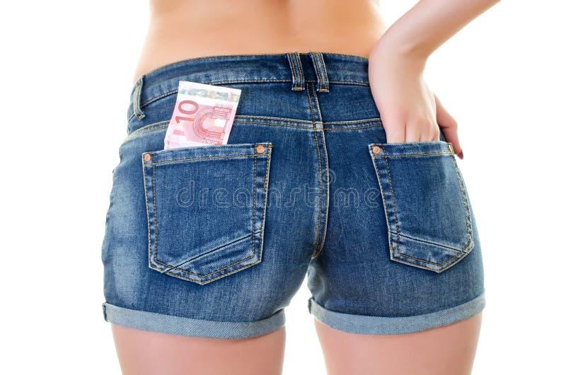 在后面口袋的欧元 免版税库存图片