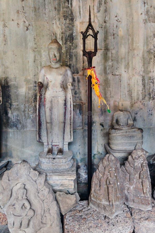 在吴哥窟的残破的菩萨雕象 库存图片