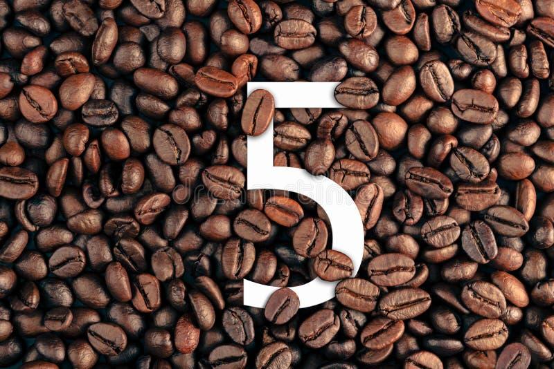在咖啡豆背景概念的第五 免版税库存图片