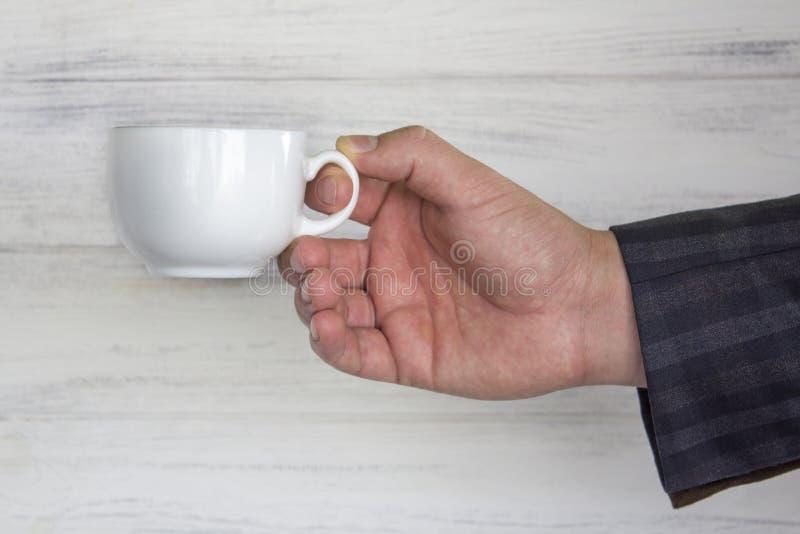 在商人` s的杯 免版税图库摄影