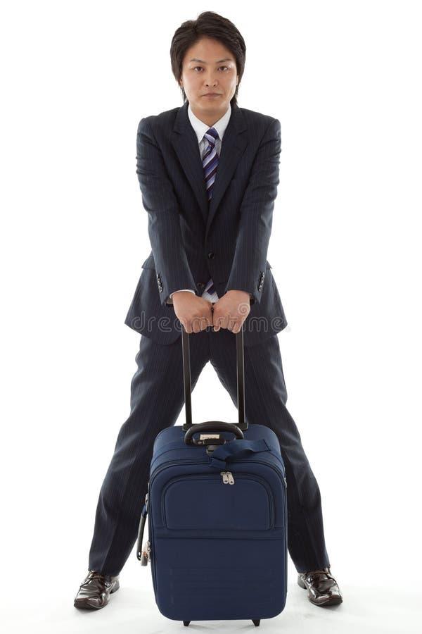 在商务旅行的新生意人 免版税库存图片