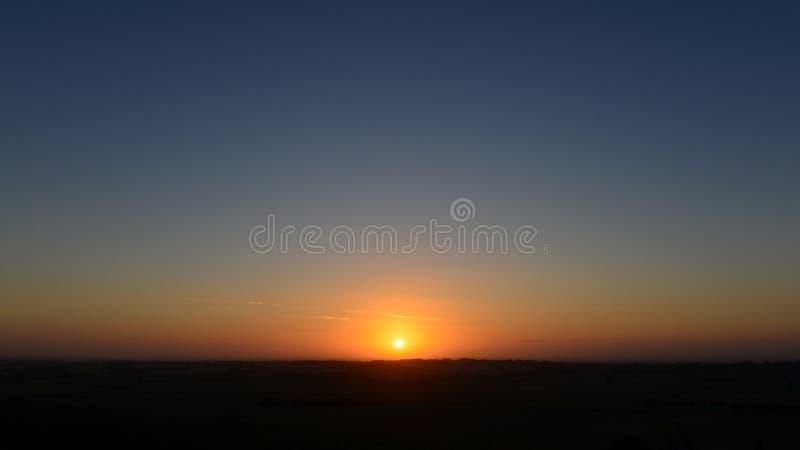 在土地的日落 库存照片