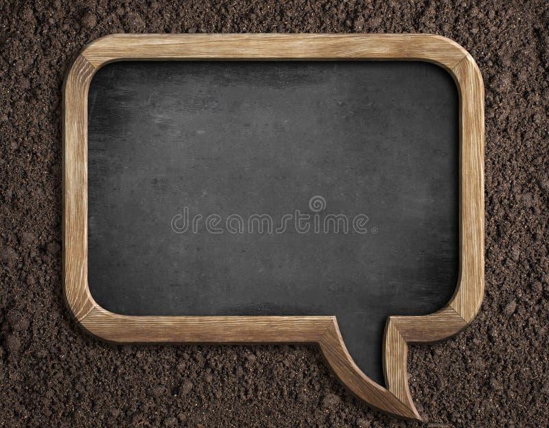 在土壤的空白的黑板播种的忠告的 免版税库存图片