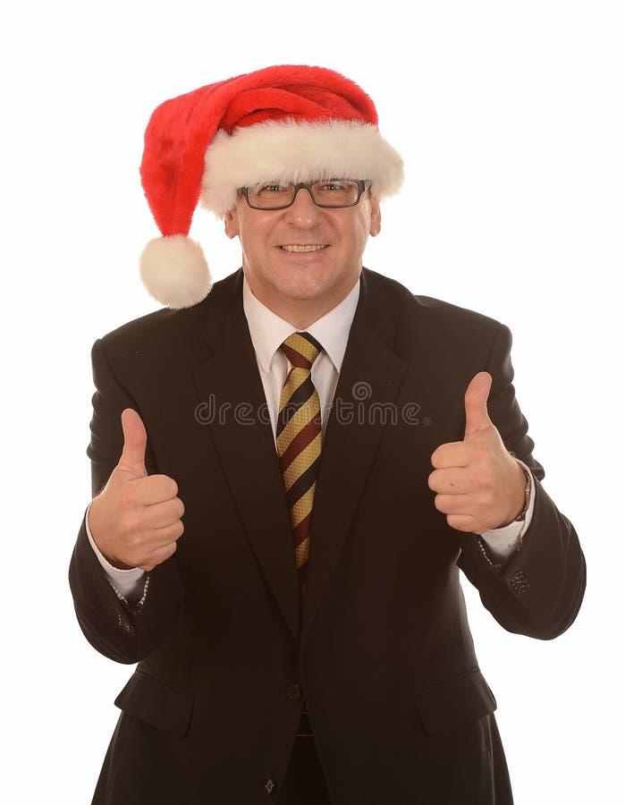 在圣诞老人帽子的生意人 免版税库存照片