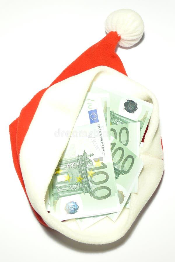 在圣诞老人里面的盖帽现金 免版税库存照片
