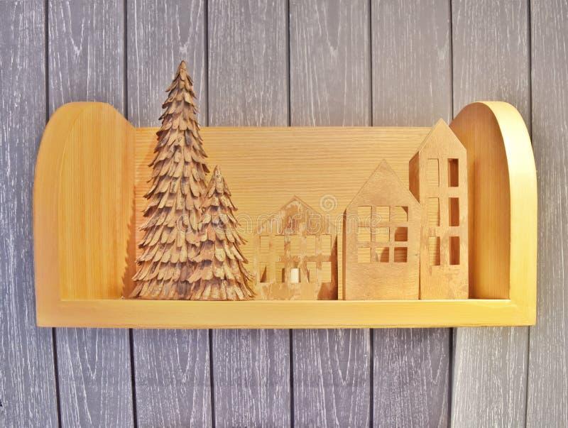 在圣诞节假日题材的木装饰在木架子 免版税图库摄影