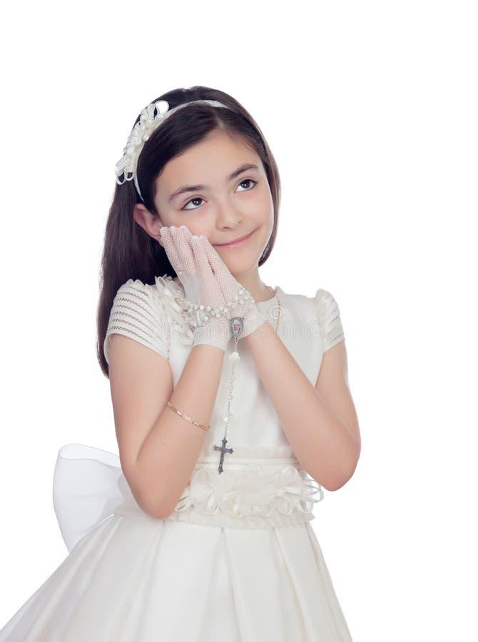 在圣餐打扮的可爱的小女孩 免版税库存图片