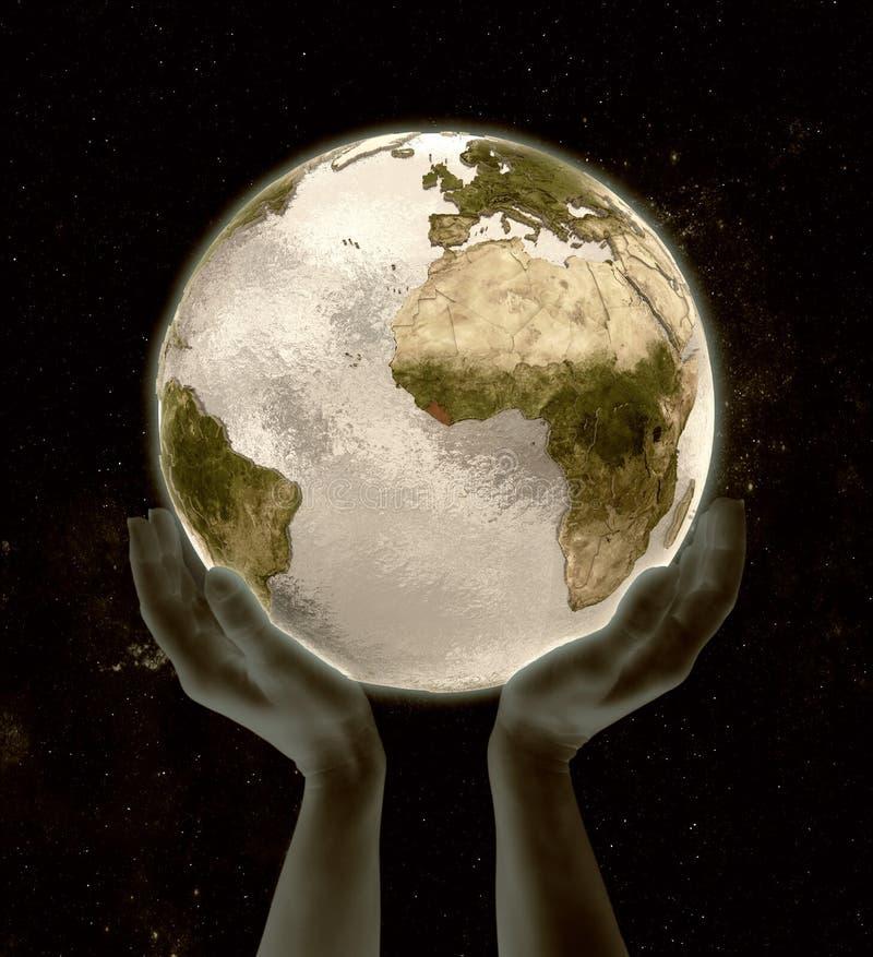 在地球胜利手上的利比里亚 向量例证